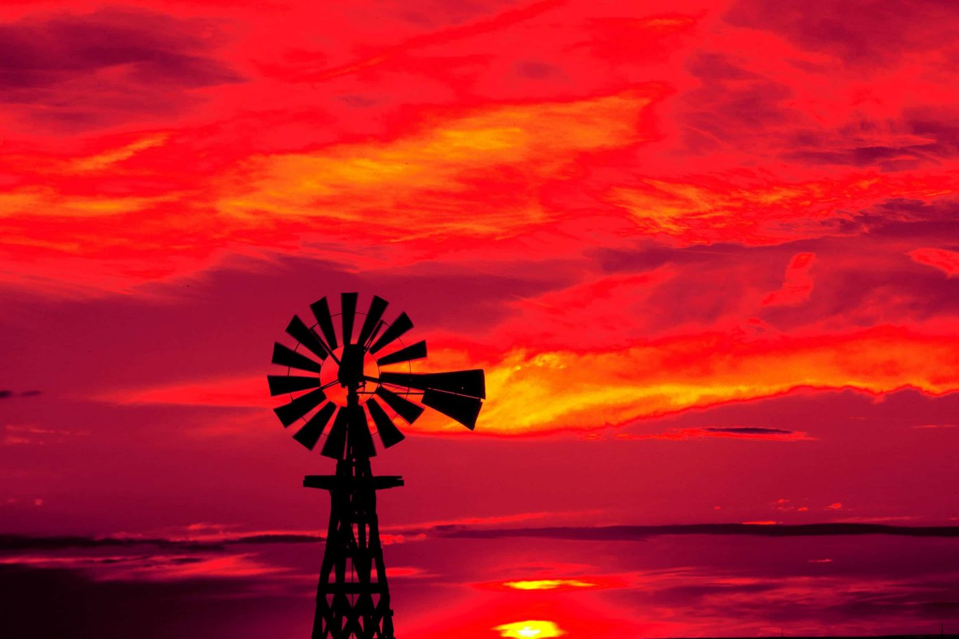 Windmill silhouetted at sunset in eastern Colorado.